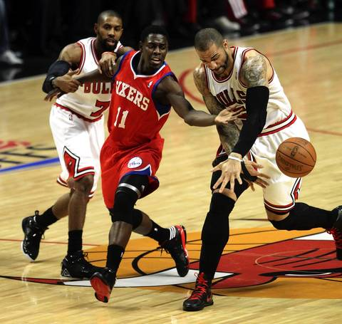Chicago Bulls power forward Carlos Boozer steals the ball from Philadelphia 76ers point guard Jrue Holiday in the first quarter of game 5 of the first round of NBA playoffs at the United Cente.