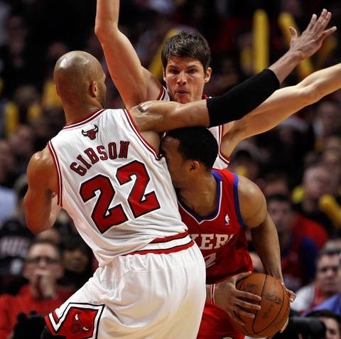 Philadelphia 76ers shooting guard Evan Turner is trapped by the defense of Chicago Bulls forward Taj Gibson and Kyle Korver in the second quarter at the United Center.