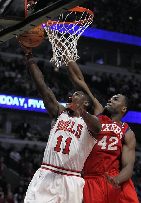 Chicago Bulls shooting guard Ronnie Brewer tries to get to the rim against Philadelphia 76ers power forward Elton Brand in the second quarter at the United Center.
