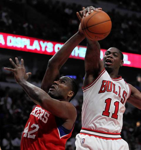 Chicago Bulls shooting guard Ronnie Brewer blocks a shot by Philadelphia 76ers power forward Elton Brand in the fourth quarter at the United Center.