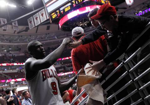 Chicago Bulls small forward Luol Deng is congratulated by fans as he leaves the court after the win over the Philadelphia 76ers in Game 5 of an Eastern Conference first-round playoff series at the United Center.