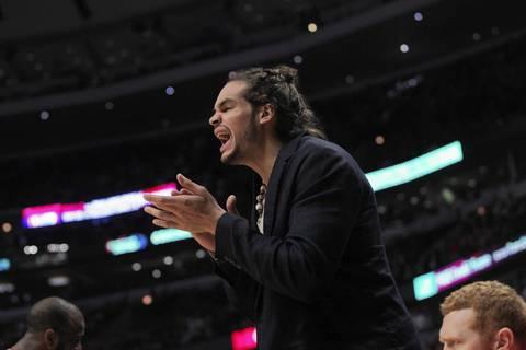 Chicago Bulls center Joakim Noah cheers on his teammates against the Philadelphia 76ers at the United Center.