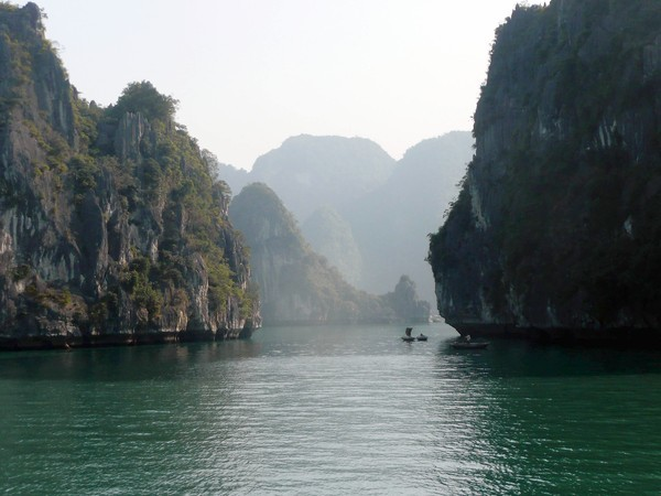 Clusters of starkly vertical islands create an otherworldly seascape in Halong Bay, Vietnam.