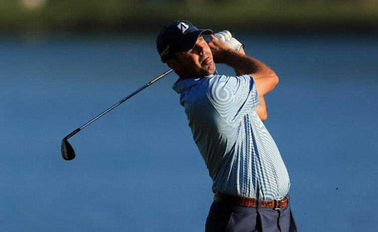 Matt Kuchar of the USA plays his second shot at the par 4, 18th hole during the second round of THE PLAYERS Championship held at THE PLAYERS Stadium course at TPC Sawgrass on May 11, 2012 in Ponte Vedra Beach, Florida. (Photo by David Cannon/Getty Images)