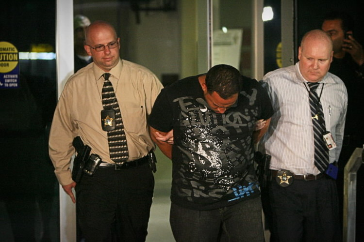 Hector Manuel Rodriguez, 31, is escorted from the Orange County Sheriff's Office in Orlando, Florida, on Friday, May 11, 2012.
