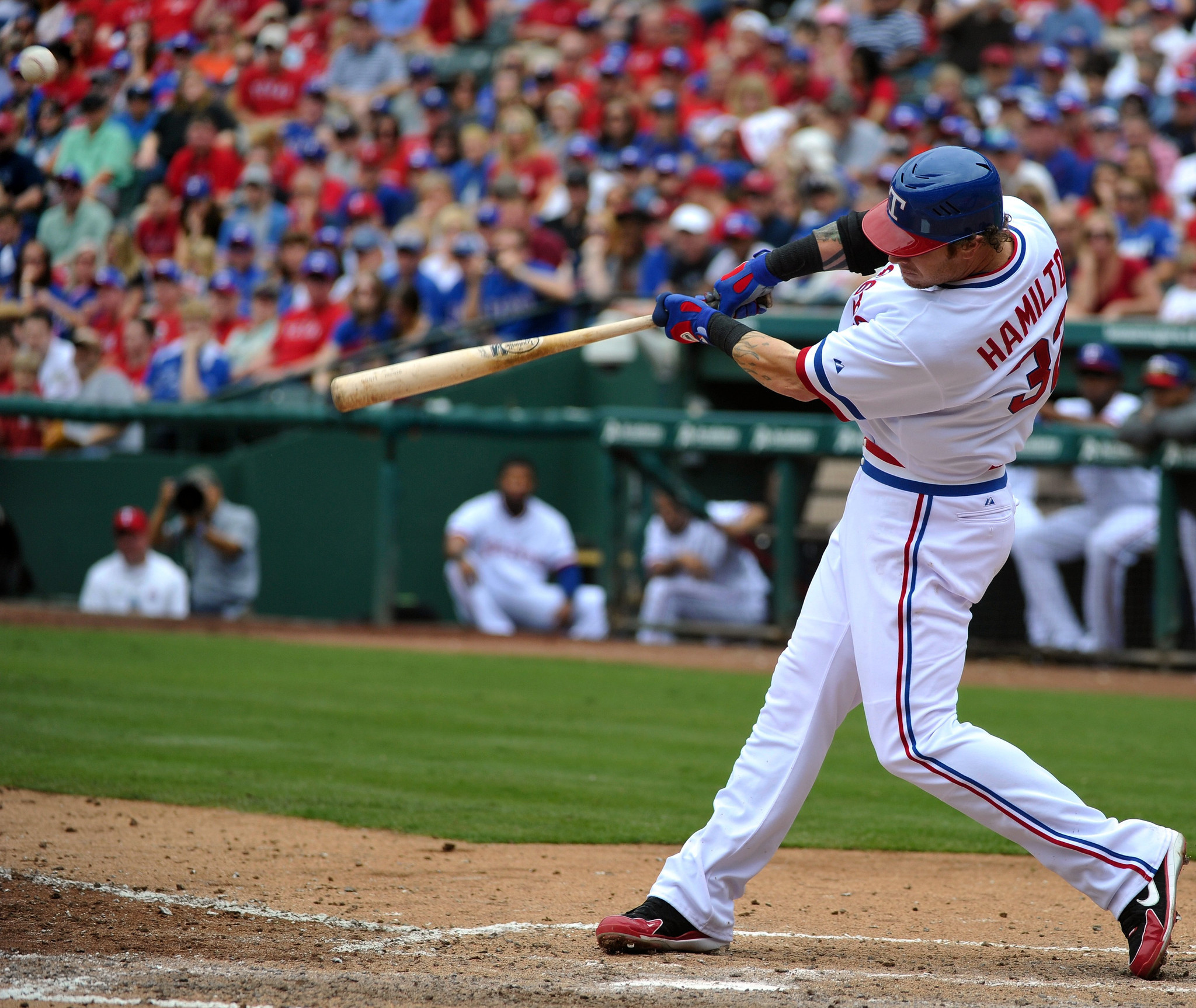 Rangers' Josh Hamilton hits a solo home run in the sixth inning against the Angels.