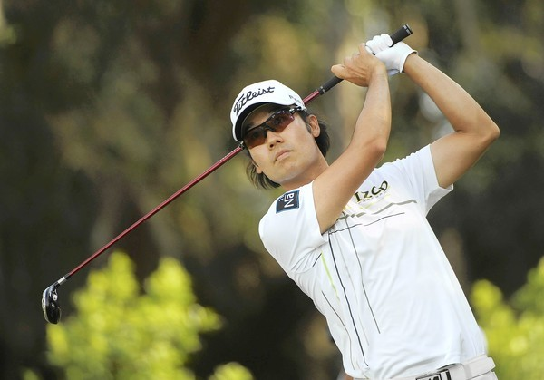 Kevin Na of the U.S. tees off on the 12th hole during the third round of the Players Championship PGA golf tournament at TPC Sawgrass in Ponte Vedra Beach.