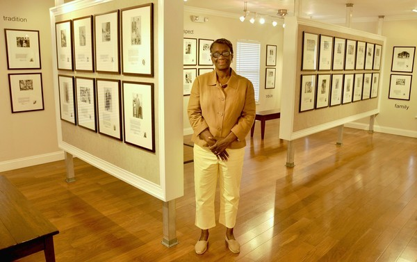 Sage Project historian Fairolyn Livingston at the exhibit recently.
