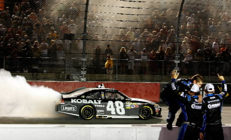 Jimmie Johnson, driver of the #48 Lowe's/Kobalt Tools Chevrolet, celebrates winning the NASCAR Sprint Cup Series Bojangles' Southern 500 with crew members at Darlington Raceway on May 12, 2012 in Darlington, South Carolina. (Geoff Burke/Getty Images for NASCAR)