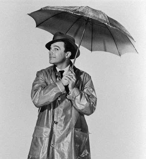 """Actor, dancer and director Gene Kelly taken during the shooting of the classic file """"Singin' in the rain"""" from 1952. No wonder it was said that the difference between Fred Astaire and Kelly is that Astaire was the person you went to the dance with and Kelly was the one you went home with."""