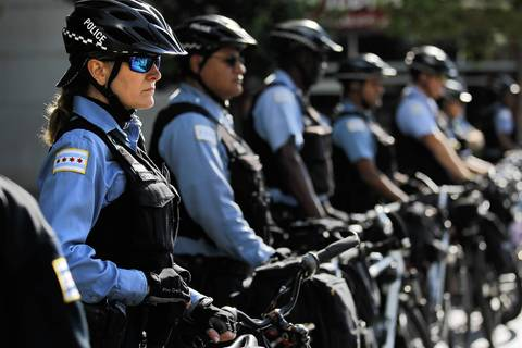 Chicago bicycle police keep an eye on the demonstrators.