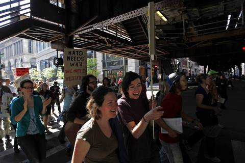 Demonstrators pass under the El tracks as they march west on Randolph Street.