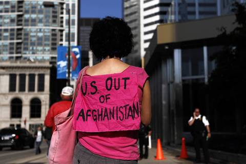 A demonstrator wears a message on her shirt.