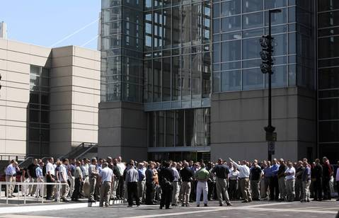 A group tours the exterior of McCormick Place. Traffic control officers stated the group was with the Army.