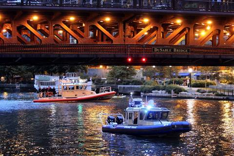 Patrol boats operated by the Chicago police and the U.S. Coast Guard block traffic on the Chicago River near the Michigan Avenue Bridge due to a suspicious package being found in the area.