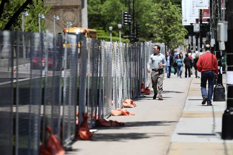 Temporary fencing surrounds the Art Institute of Chicago on Columbus Drive and Monroe Street in preparation for the upcoming NATO Summit.