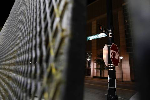 Metal fencing is in place at 24th Street and Indiana Avenue as barriers are assembled in the area around McCormick Place for the upcoming NATO Summit in Chicago.
