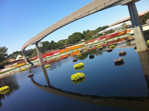 The monorail line runs over flower-adorned landscaping at Epcot for the 2012 Epcot International Flower & Garden Festival at Walt Disney World.