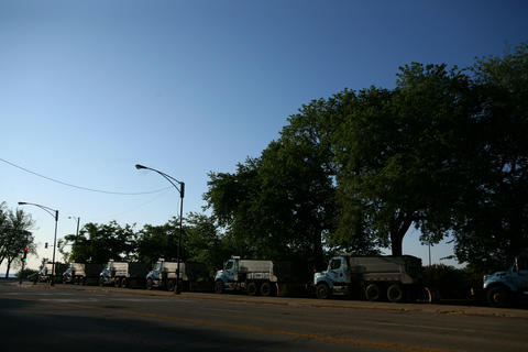 Streets and Sanitation department snow trucks line Balboa Avenue between Columbus and Lake Shore Drive.