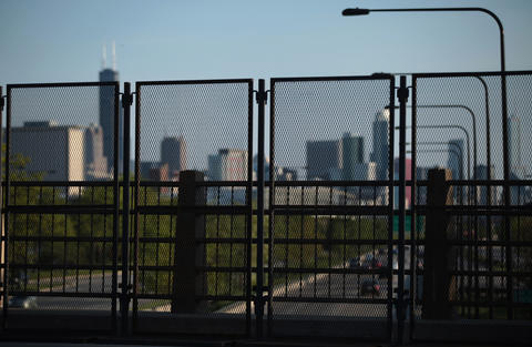 Barricade fencing stands on the 31st Street Bridge over Lake Shore Drive in preparation for the NATO Summit.