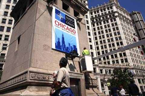 Chicago Department of Transportation workers put up a NATO banner on the Michigan Avenue bridge.