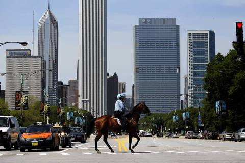 A mounted Chicago police officer crosses Columbus Drive near Grant Park as the city prepares for the NATO Summit.