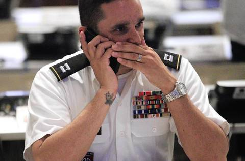 Captain Dustin Cammack of the Illinois National Guard talks on the phone at his workstation at a multi-agency communications center in suburban Chicago. The center was created as a communications hub for all the federal, state and local agencies involved with the NATO Summit.