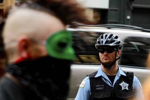 Chicago police watch over Occupy Chicago demonstrators on North State Street in Chicago.
