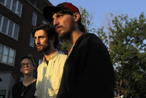 Zoe Sigman (left) and brothers William Vassilakis and Michael Vassilakis of Occupy Chicago stand outside the Chicago police department's organized crime division in the 3300 block of W. Fillmore. William Vassilakis says his Bridgeport apartment was raided by Chicago police last night and nine fellow demonstrators were taken into custody and are now being held at this station.
