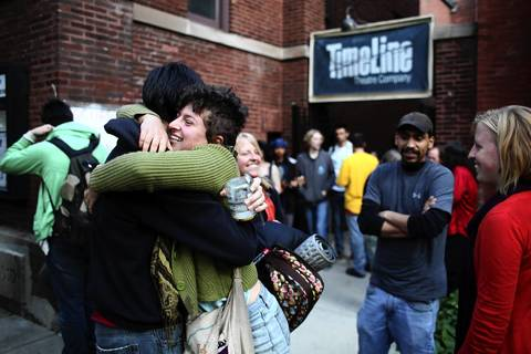 Out of town Occupy protesters greet one another outside of Wellington Avenue United Church of Christ.