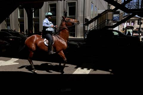A member of the Chicago police department mounted patrol rides on Wabash Avenue moments before Occupy Chicago demonstrators arrive in the area.