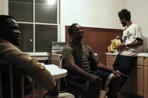 Members of Occupy Atlanta, Glenn Russ, 20, from left, Hassan Ford, 27, and Jenell Holden, 36, all rest in the kitchen of Terry Keenan's Bucktown kitchen. Keenan offered his home as a place to stay for members of Occupy Atlanta for NATO.