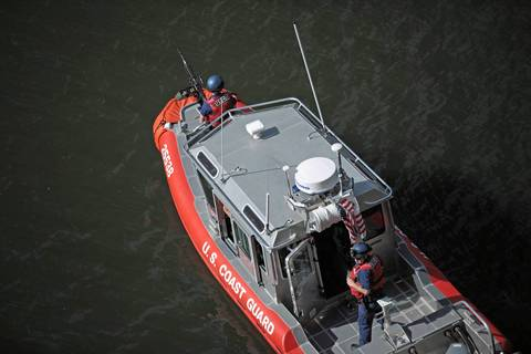 A Coast Guard boat patrols the Chicago River near Columbus Drive Friday morning. Some of the first outward signs of atypical security for the NATO summit were on the water this morning, with at least two small Coast Guard boats idling on the river.