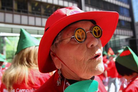 Kay McVay, and RN from Oakland, Calif., wearing upside down peace glasses that she has had since 1959, arrives at Daley Plaza for the National Nurses United protest.