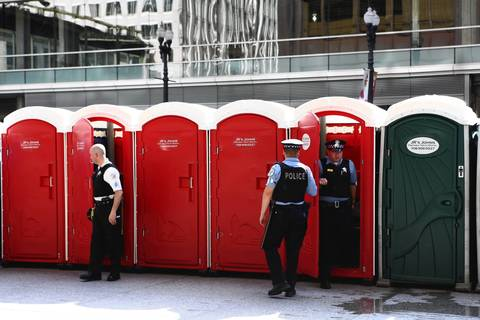 Chicago police officers take a bathroom break a few hours before a protest, led by a California-based nurses organization, is set to begin at Daley Plaza.