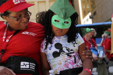 Leah Hart, 6, of Detroit, is not too pleased with attending National Nurses' protest rally with her mother Lashon at Daley Plaza in Chicago before the NATO Summit in Chicago.