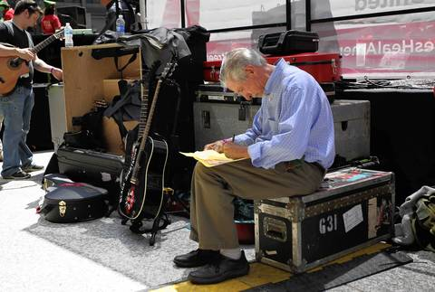 Activist Tom Hayden prepares his speech backstage at the National Nurses Protest at Daley Plaza.