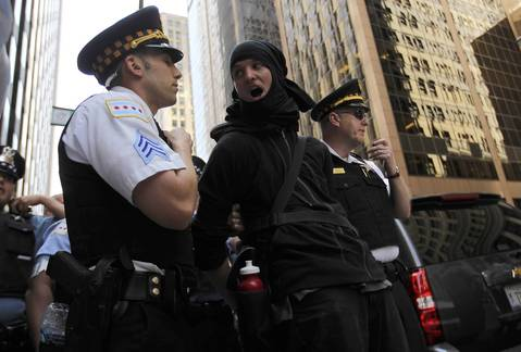 A protester is detained at the National Nurses protest rally at Daley Plaza in Chicago.