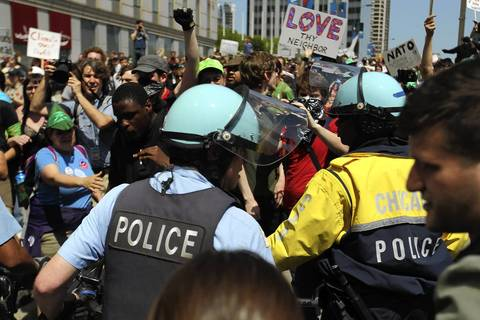 Chicago Police momentarily stop march on Randolph Street before letting protesters through during a march after National Nurses protest rally at Daley Plaza.