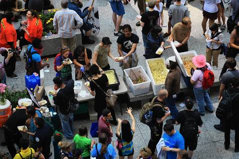 Demonstrators break for some food during a protest rally at the Daley Center Plaza.
