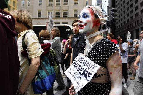 Clown Bloq member Evelyn Dhais arrives at National Nurses protest rally at Daley Plaza in Chicago before the NATO Summit.
