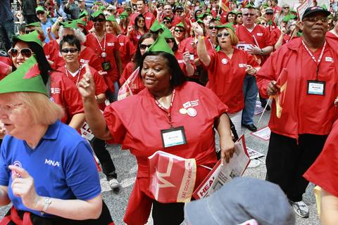 Beverly Abrams (center) of Georgia rallies with fellow protesters led by a California based nurses organization at Chicago's Daley Plaza. It was the first major demonstration of the NATO Summit weekend in Chicago.