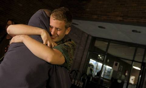 Robert LaMorte, 21, receives a hug from a friend after he was released by police at the Chicago Police Department's Area 4 station.