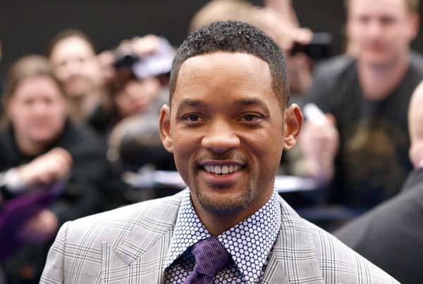 Will Smith acknowledges the crowd as he arrives on May 16, 2012 for the UK Premiere of 'Men In Black III', in London's Leicester Square.