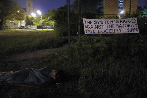 An Occupy protester sleeps outside of the Woodlawn Mental Health Clinic as The Mental Health Movement and Occupy Chicago collaborated to protest closured of mental health facilities by the City of Chicago.