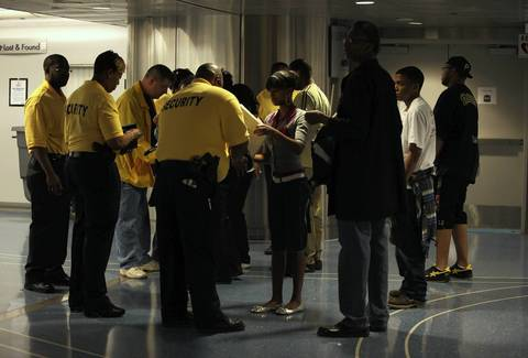 Metra security personnel search passengers' bags before they board the trains at Randolph and Michigan in Chicago.