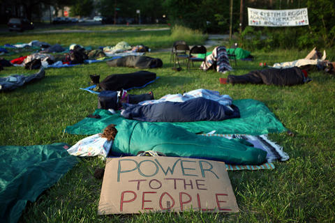 The sun rises over protesters outside of Wellington Avenue United Church of Christ on Saturday morning.