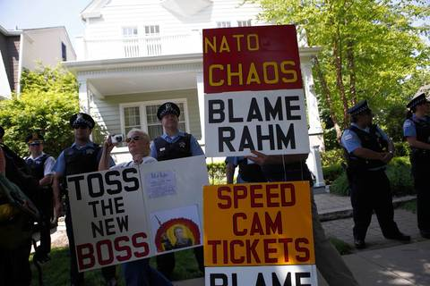 Police guard Mayor Rahm Emanuel's North Side home Saturday as a small group of protesters gather targeting the NATO Summit and city healthcare cuts.