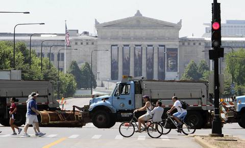 The Field Museum creates a formal backdrop to the Streets and Sanitation Department trucks blocking Lake Shore Drive at Balbo Drive.
