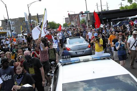 Protesters surround vehicles as they march down Montrose Avenue to Mayor Rahm Emanuel's house.